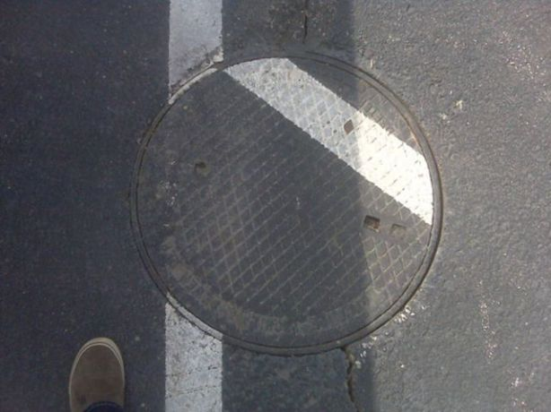 misaligned man hole cover